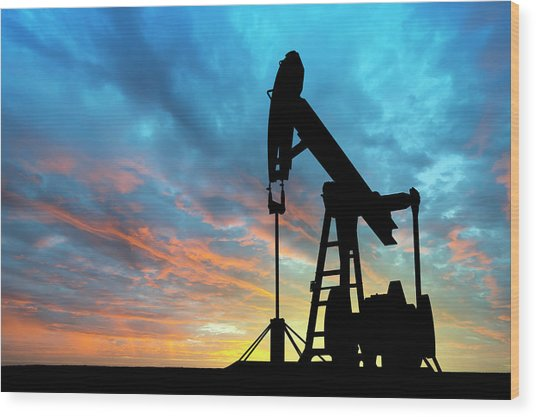 Dawn Over Petroleum Pump Wood Print by Grafissimo