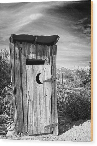 Desert Outhouse Under Stormy Skies Wood Print