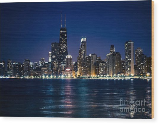 Downtown City Of Chicago At Night Wood Print by Paul Velgos