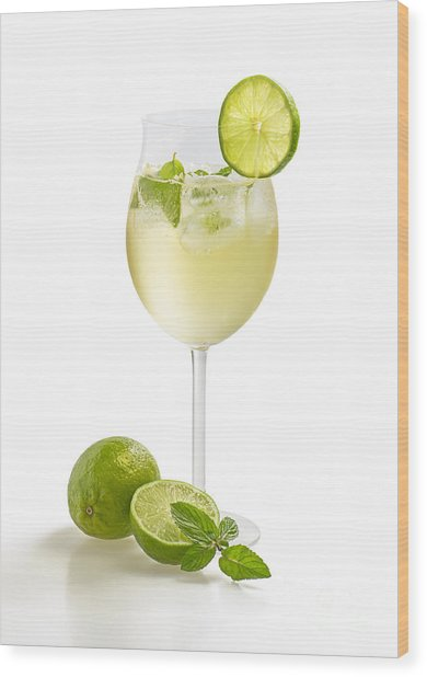 Drink With Lime And Mint In A Wine Glass Wood Print by Palatia Photo