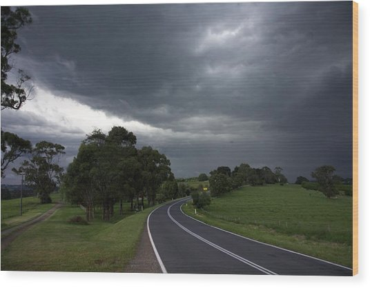 Driving Into A Storm Wood Print by Lee Stickels