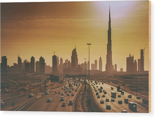 Dubai Cityscape With Skyscrapers And Wood Print by Serts