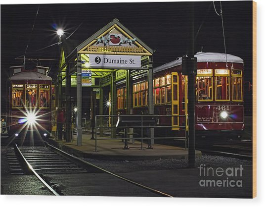 Dumaine St. Trolly In New Orleans Wood Print by Kent Taylor