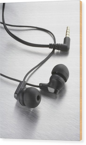 Earphones Using Neodymium Magnets Wood Print by Science Photo Library