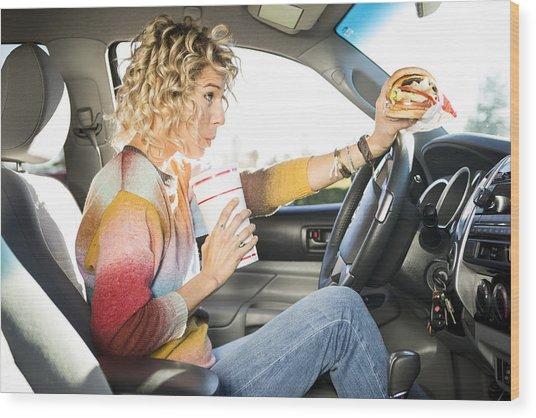 Eating Fast Food Hamburgers And Driving. Wood Print by Jordan Siemens