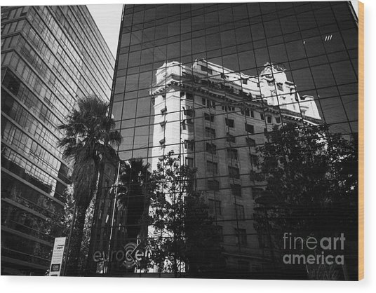 edificio ariztia building reflected in modern bank buildings in the financial district of Santiago Chile Wood Print by Joe Fox