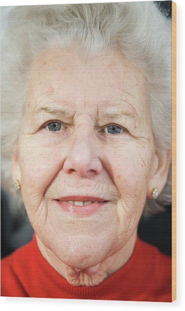 Elderly Woman Smiling Wood Print by Cristina Pedrazzini/science Photo Library