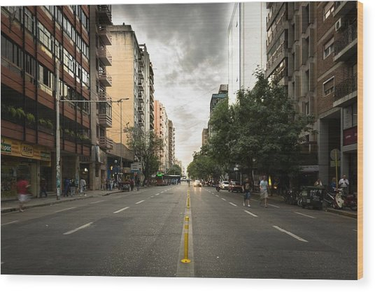 Empty Road Along Buildings Wood Print by Andres Ruffo / EyeEm