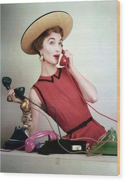 Evelyn Tripp Holding Telephones Wood Print by Erwin Blumenfeld