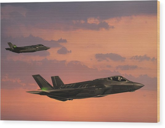 F-35 Fıghter Jets In Flight At Sunset Wood Print by Guvendemir