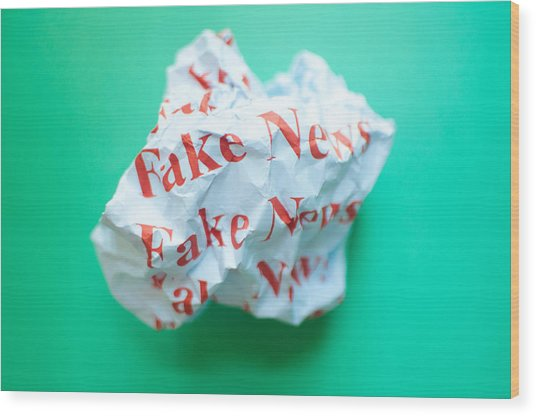 Fake News Against Blue Green Background Wood Print by Karl Tapales