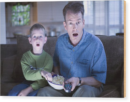 Father And Son With Remote Control And Popcorn Wood Print by Thinkstock Images