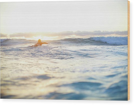 Female Surfer Swimming Out To Waves On Wood Print by Moof