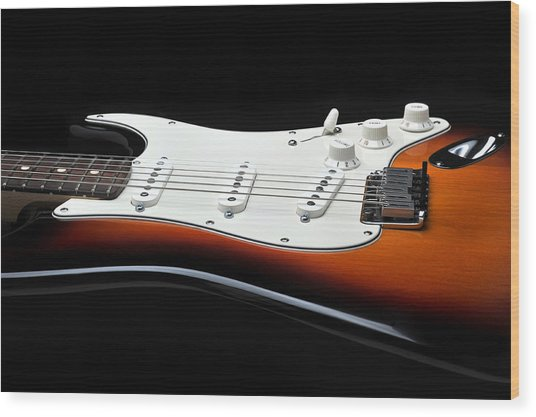 Fender Stratocaster Guitar On Black Background Wood Print