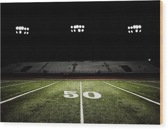 Fifty-yard Line Of Football Field At Wood Print by Jgareri