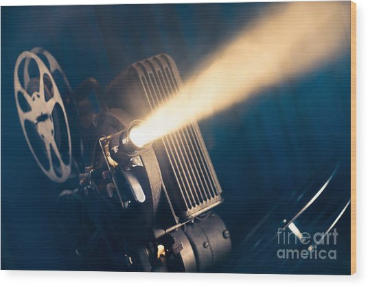 Film Projector On A Wooden Background Wood Print