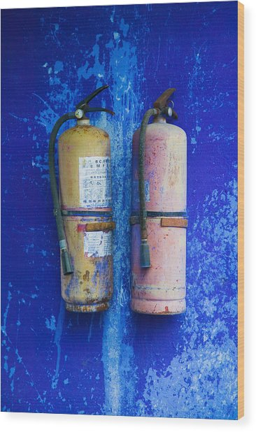 Fire Extinguishers On Blue Temple Wall Wood Print