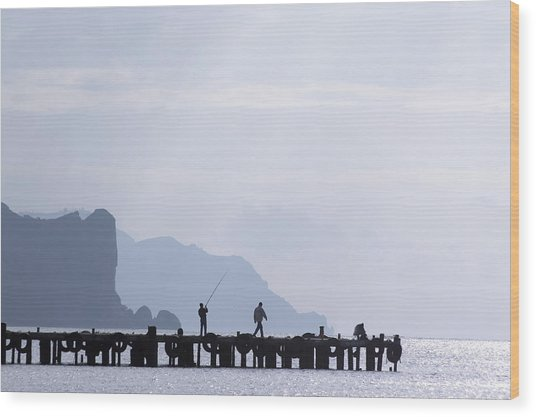 Fisherman At The Pier Wood Print