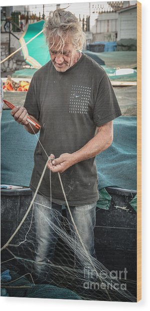 fisherman mending nets on Anzio harbour Wood Print