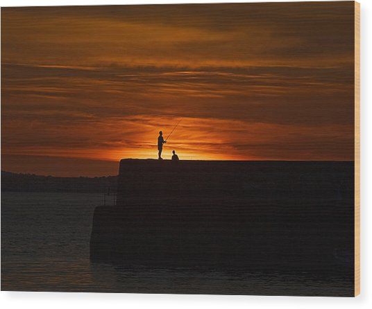 Fishing As Sunset Wood Print by Tony Reddington