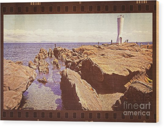 Fishing At Noon By The Lighthouse Wood Print
