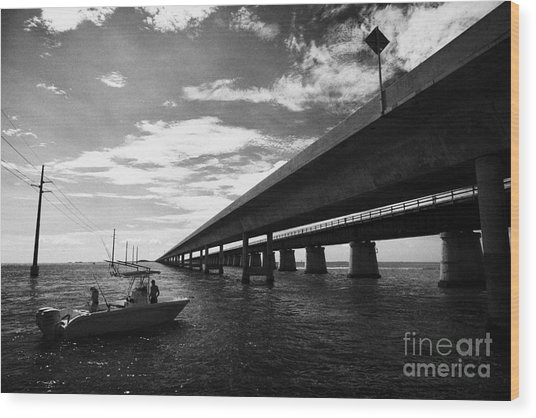 Fishing Boat Beneath New Seven Mile Bridge In Marathon In The Florida Keys Wood Print by Joe Fox