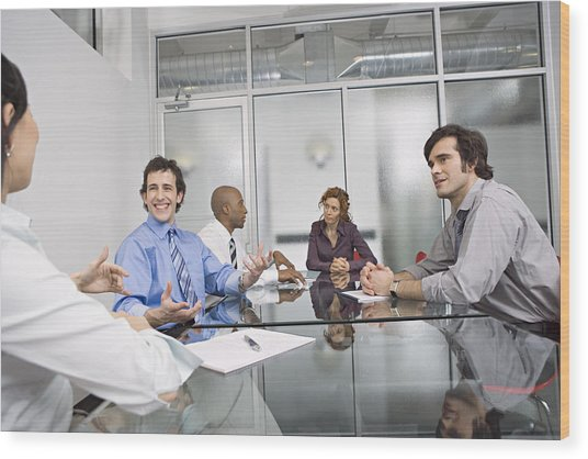 Five Businesspeople Sitting At Conference Table, Discussing Wood Print by Bob Handelman