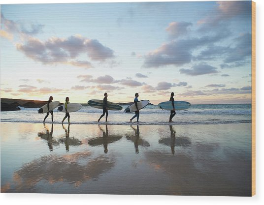 Five Surfers Walk Along Beach With Surf Wood Print by Dougal Waters