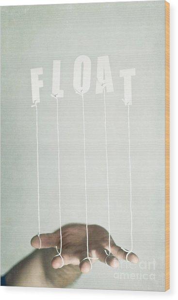 Float Wood Print by Catherine MacBride