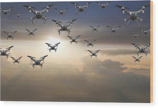 Flock Of Drones In The Sky At Sunset Wood Print by Buena Vista Images