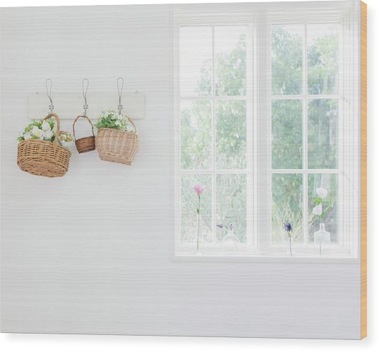 Flowers In Baskets On Wall Wood Print by Bloom Image
