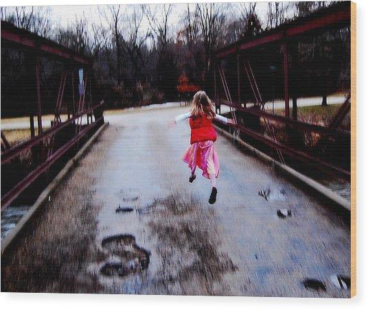 Flying On The Bridge Wood Print by Jon Van Gilder