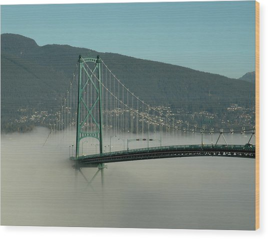 Fog Engulfing The Lion's Gate Bridge Wood Print