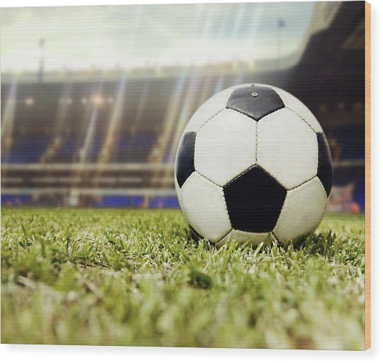 Football Ball At The Stadium Wood Print by Andresr
