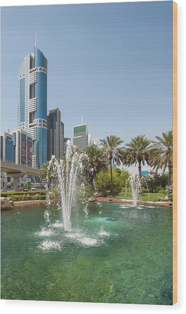 Fountain And Downtown Skyline Of Dubai Wood Print