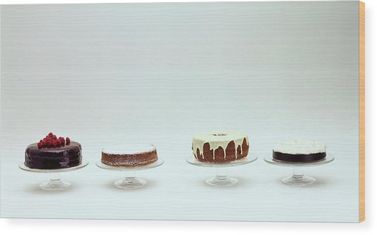 Four Cakes Side By Side Wood Print