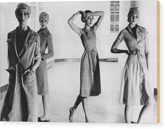 Four Models Standing In A Hallway Wood Print