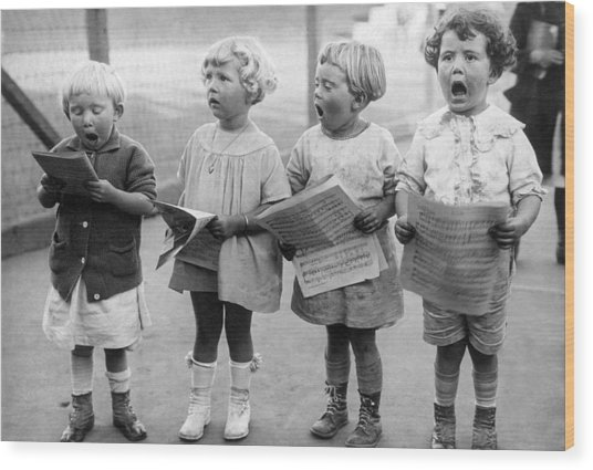 Four Young Children Singing Wood Print