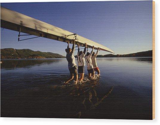 Four Young Women Carrying Canoe Into Lake Wood Print by Bob Handelman