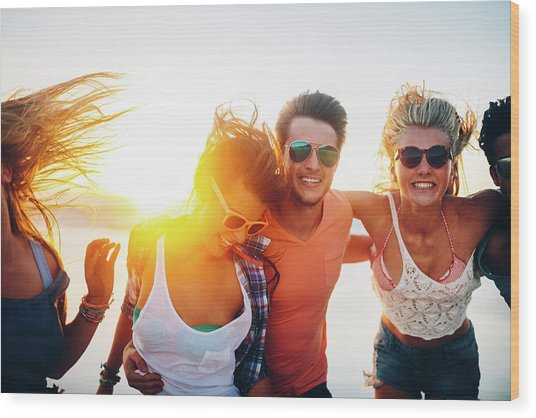Friends Dancing On Beach In Sunset Wood Print by Wundervisuals