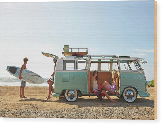 Friends With Van Relaxing On Beach Wood Print by Colin Anderson Productions Pty Ltd
