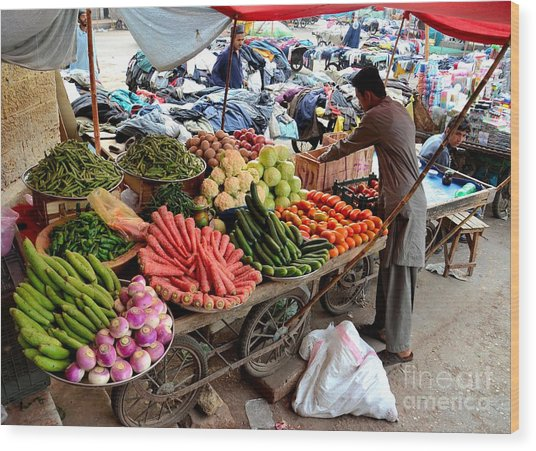 Fruit And Vegetable Seller Tends To His Cart Outside Empress Market Karachi Pakistan Wood Print