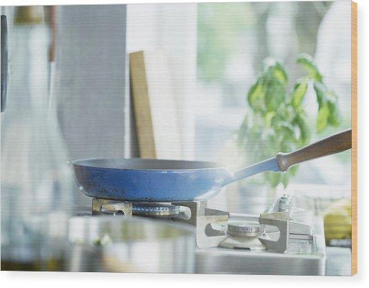 Frying Pan On Lit Hob Wood Print by Ingolf Hatz