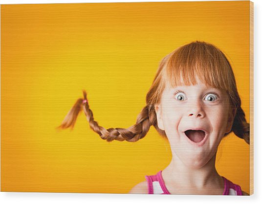 Gasping Red-haired Girl With Upward Braids And Excited Look Wood Print by Ideabug