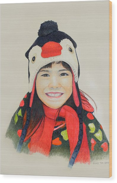 Girl In The Penguin Cap Wood Print