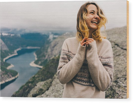 Girl Laughing On The Trolltunga Wood Print by Oleh_Slobodeniuk