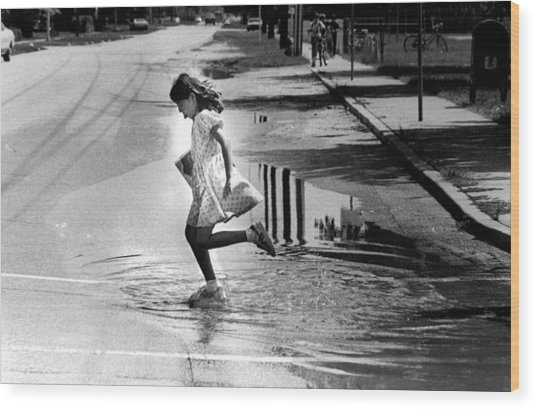 Girl Playing In A Puddle Wood Print by Retro Images Archive