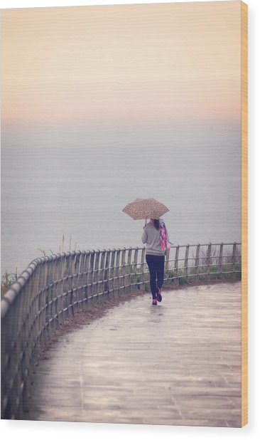 Girl Walking With Umbrella Wood Print