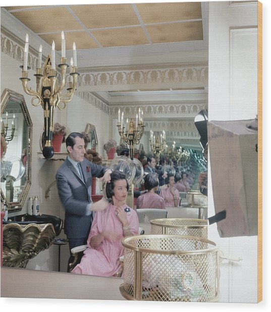 Gloria Vanderbilt At The Revlon Boutique Wood Print by Horst P. Horst