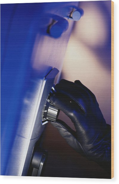 Gloved Hand Opening A Safe Wood Print by Photodisc